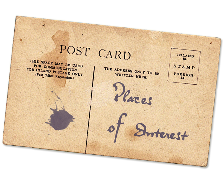 The back side of an old and worn looking postcard bearing the hand-written title Places of Interest
